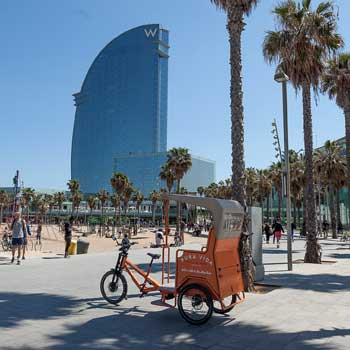 Pedicab parked by the W-hotal in Barcelona